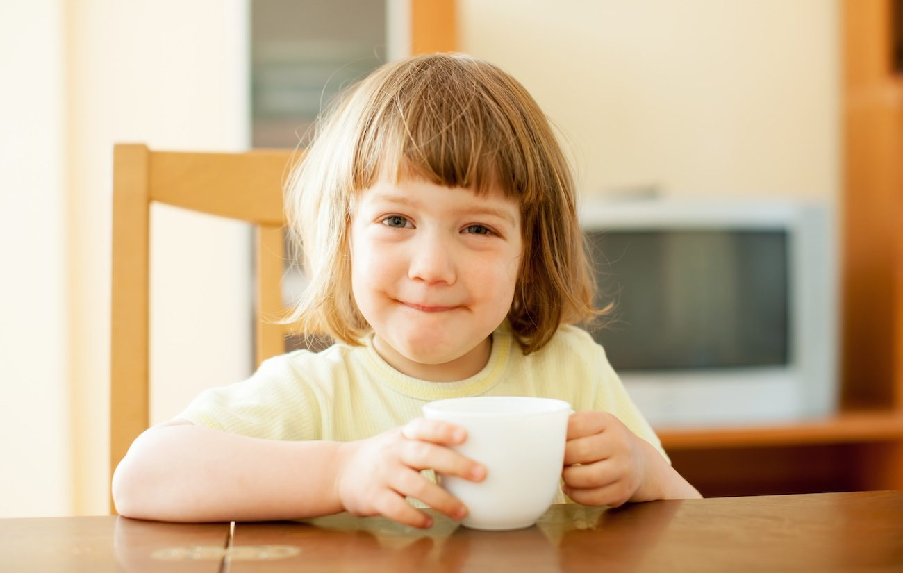 2 years child drinking from cup in home